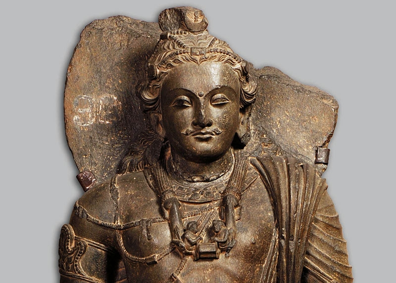 Standing bodhisattva Maitreya. Pakistan. 3rd–4th century. Grey schist. H. 39 3/8 x W. 15 3/16 x D. 5 1/2 in. (100 x 38.5 x 14 cm). Central Museum, Lahore, G-131.