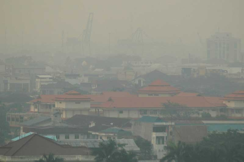 In a picture taken on September 9, 2009 haze covers Pontianak city in Kalimantan on Indonesia's Borneo island. The number of haze-causing spot fires on Indonesia's half of Borneo island have more than doubled, sending pollution into Malaysia, officials said on September 29, 2009. (AFP/AFP/Getty Images)