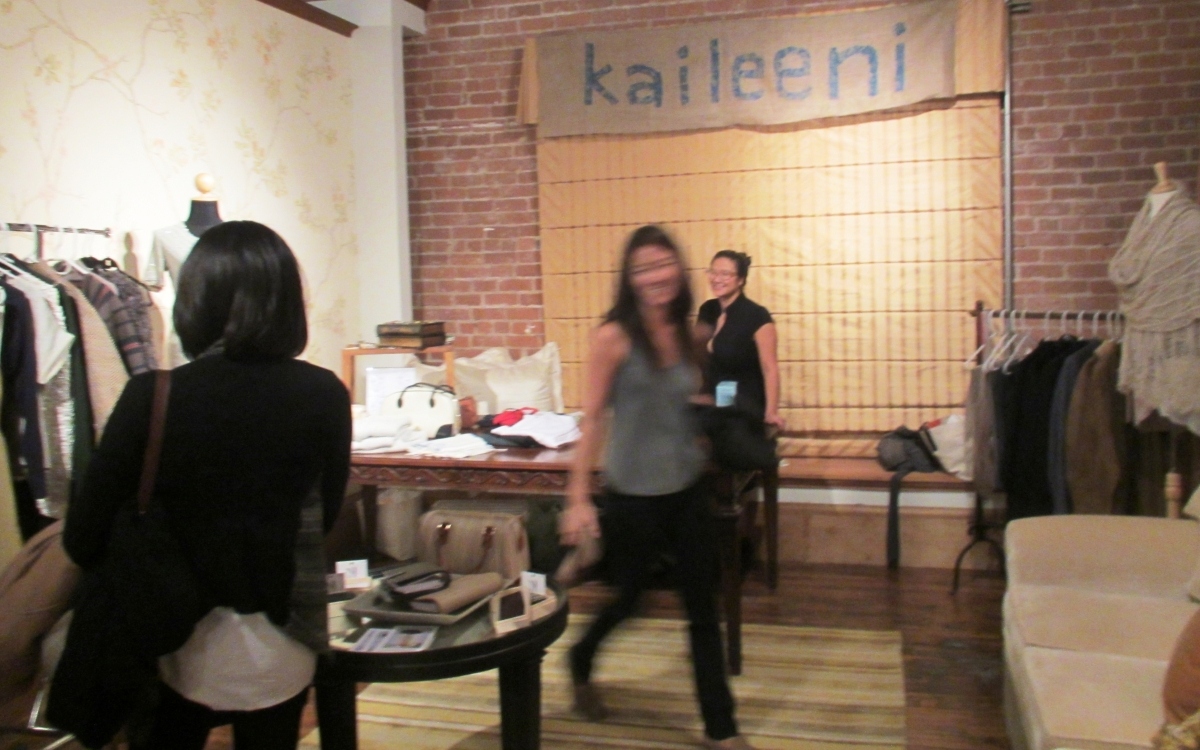 Cairn Wu of Kaileeni, co-organizer and trunk show vendor, prepares for shoppers