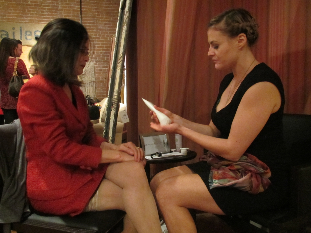 Wendy Soone-Broder of Asia Society receives a hand massage from Cetana Spa's Alexis Klein
