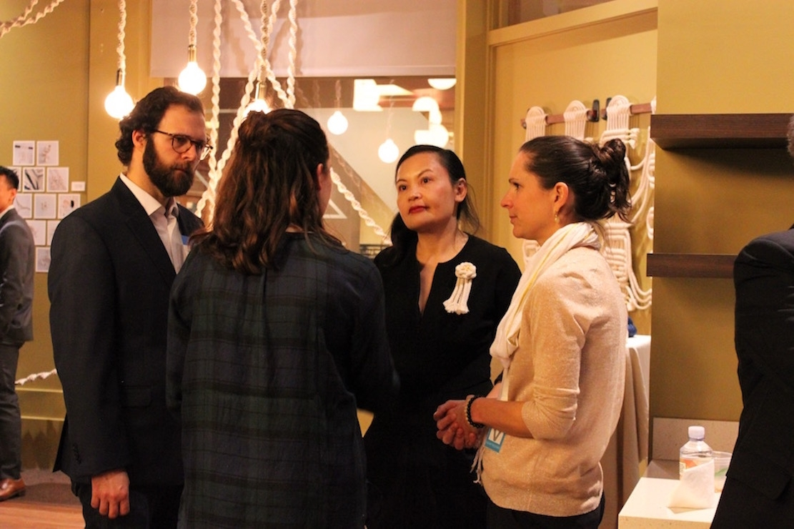 Artist Windy Chien speaks with guests during the reception (Ranna Iglesias Asia Society).