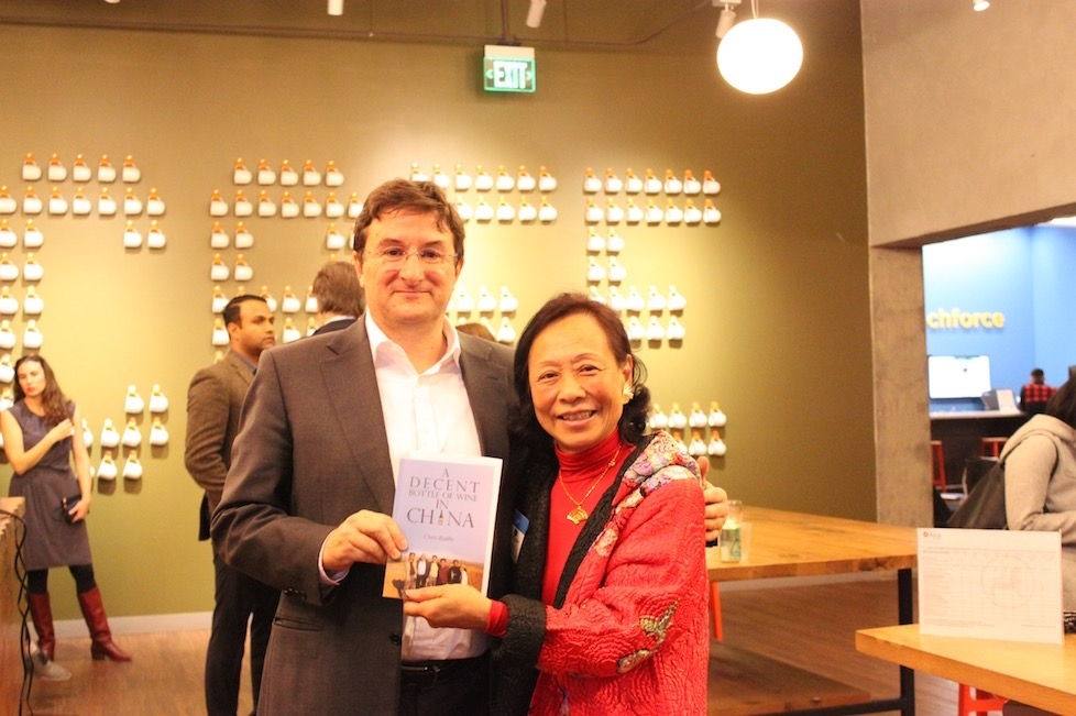 Chris Ruffle poses with a guest after signing his memoir, A Decent Bottle of Wine in China (Ranna Iglesias Asia Society).