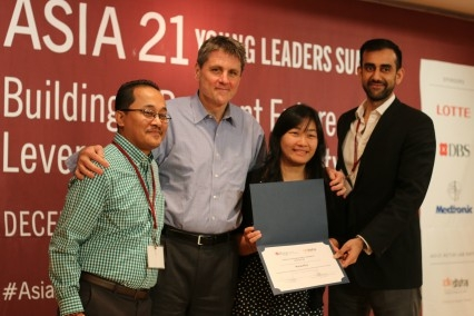 Asia Society Executive Vice-President Tom Nagorski and Executive Director Sanjeev Sherchan present Kristen Kagetsu, CEO & Co-Founder, Saathi with the 2016 Action Lab Award