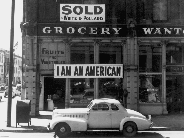 A banner posted by a Japanese American store owner the day after Pearl Harbor.