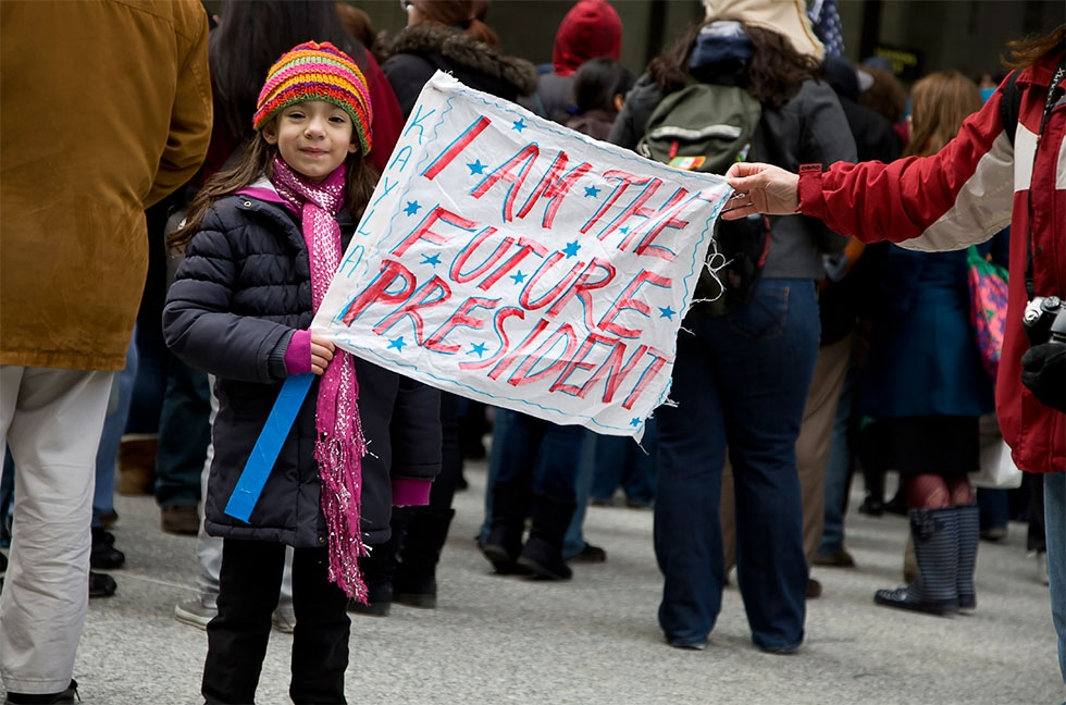 A girl at an immigration rally in Daley Plaza in Chicago (Joseph Mietus/Flickr)