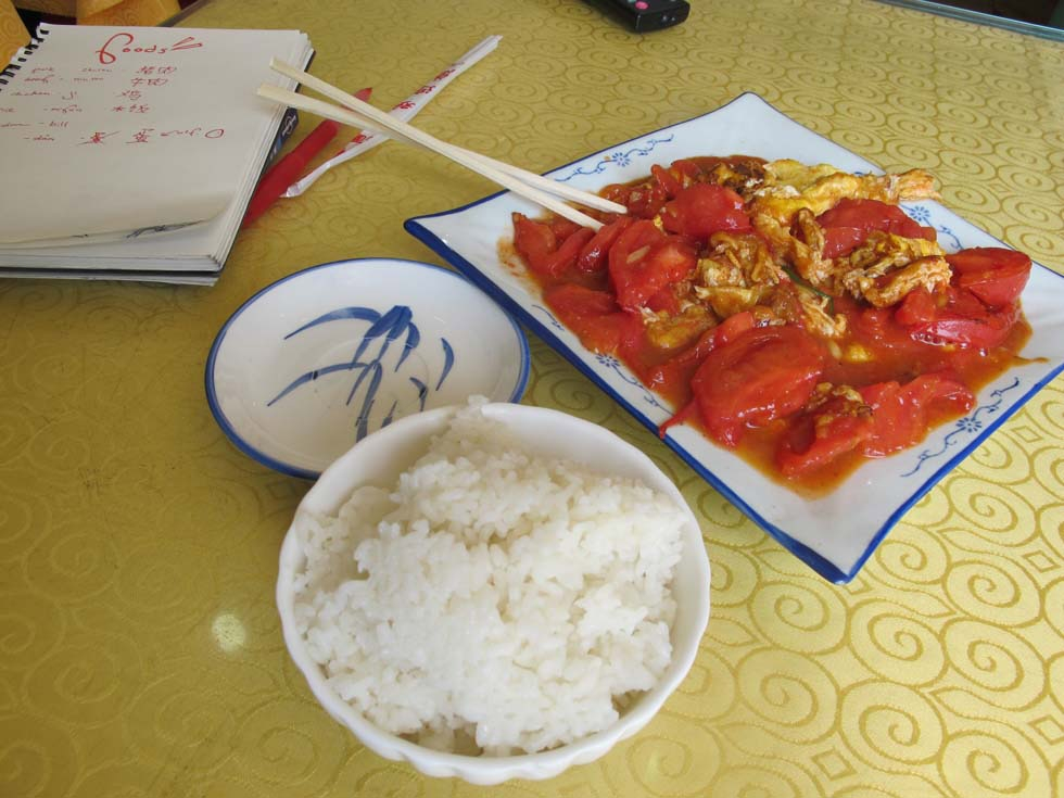 Tomato-egg stir fry with white rice, a common Chinese home dish. (Julia Dorff)