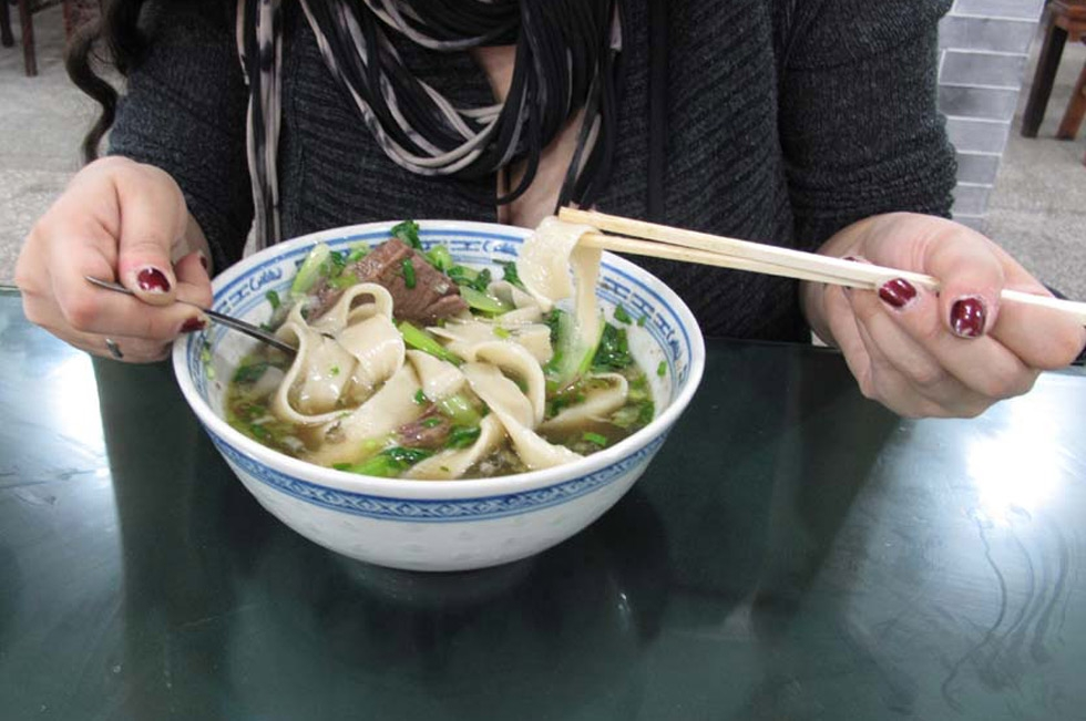 Sliced boiled lamb hand-ripped soup noodles from Xi'an, China. (Julia Dorff)