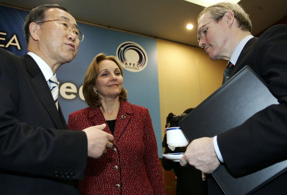 South Korean Foreign Minister Ban Ki-Moon (L) talks with U.S. Assistant Secretary of State Christopher Hill (R) as Undersecretary of State Josette Sheeran (C) listens at an Asia Pacific Economic Cooperation (APEC) ministerial meeting in Busan on November 15, 2005. (Toru Yamanaka/AFP/Getty Images)