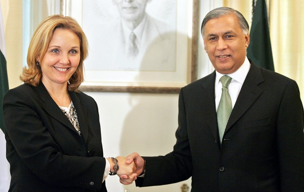 Pakistan's Prime Minister Shaukat Aziz (R) shakes hands with visiting U.S. Under Secretary of State for Economic, Business and Agricultural Affairs, Josette Sheeran prior to a meeting in Islamabad, 23 May 2006. (Aamir Qureshi/AFP/Getty Images)