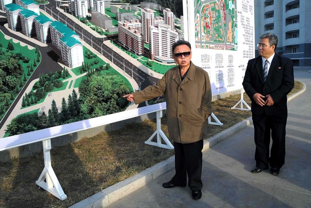 North Korean leader Kim Jong Il inspecting a newly-built apartment complex in Pyongyang, North Korea, in an undated image released in October 2009. (KNS/AFP/Getty Images)