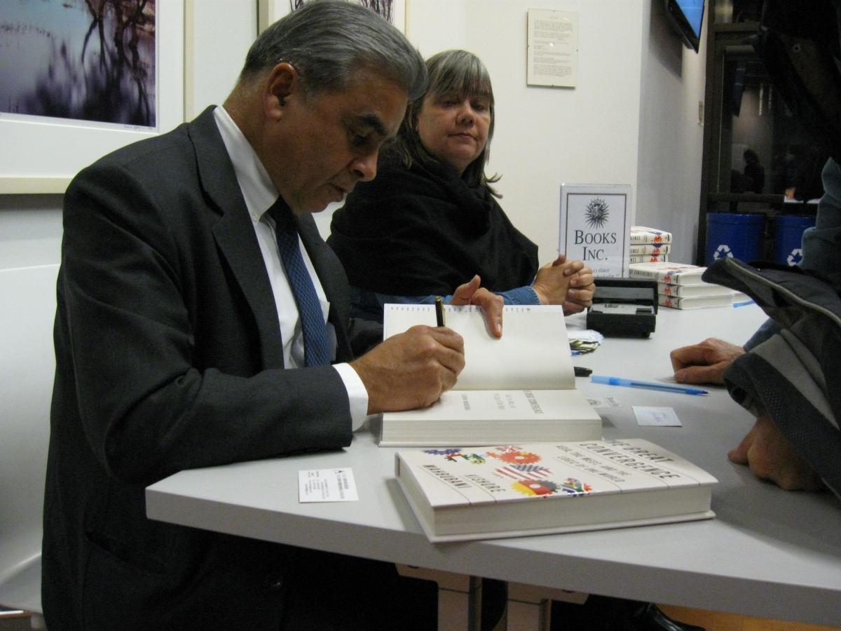 Mahbubani signed books at the event.