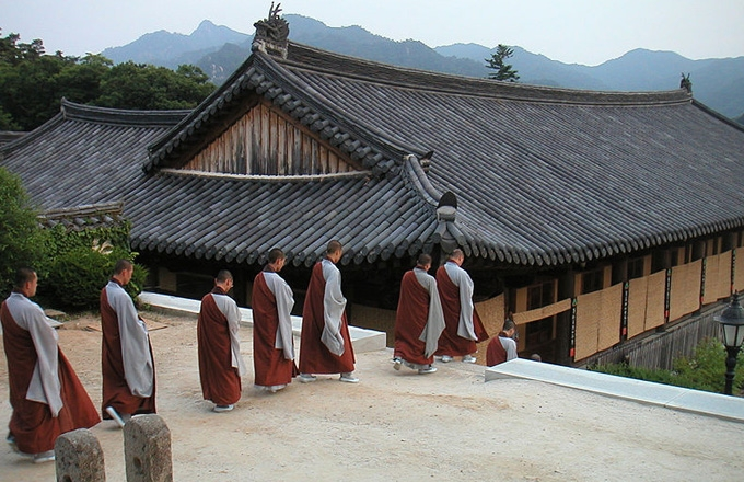 Monks going down to their rooms after evening worship at Haeinsa.