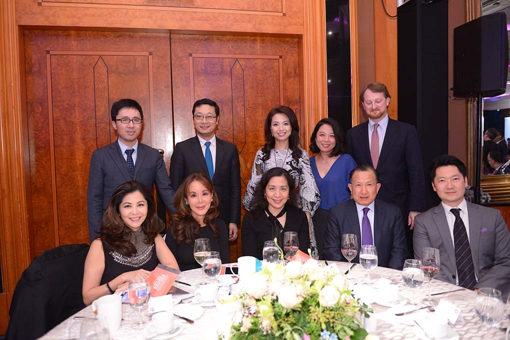 Asia Society Trustee Guoqing Chen (seated second from right) and guests.