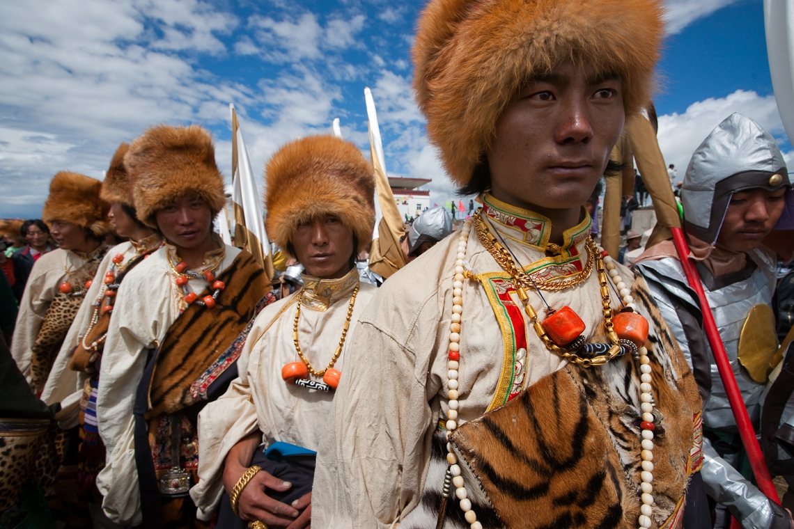 Not to be outdone by the ladies, these men wear heirloom costumes made with leopard and tiger skins and red fox fur hats. (Michael Yamashita)
