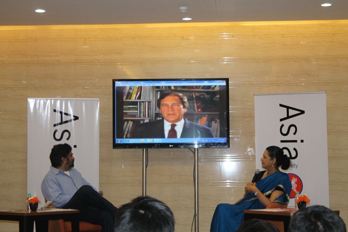 L to R: Hartosh Singh Bal, Ambassador Karl F. Inderfurth (onscreen) and Ambassador Meera Shankar. (Asia Society India Centre)