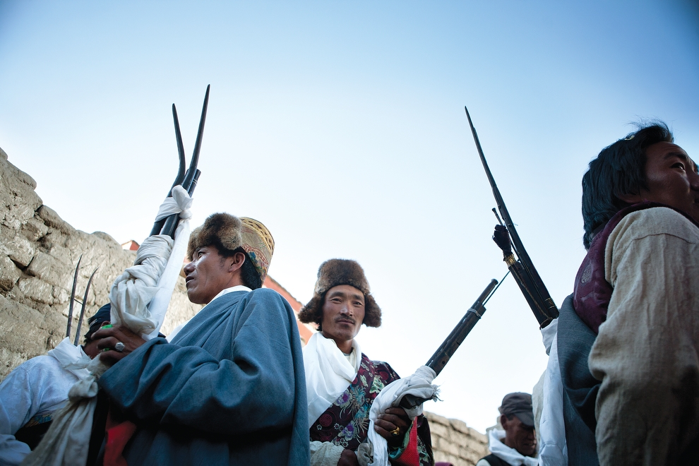 At the end of the Tiji festival, members of the king's court gather with their muskets to chase the demon from the city.  (Taylor Weidman)