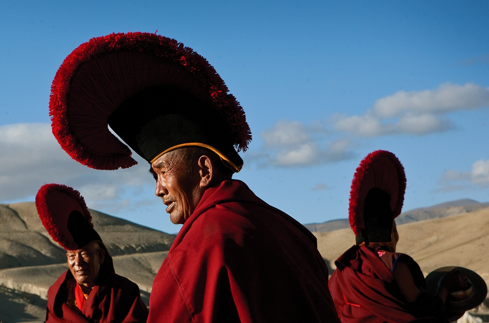 A group of senior monks gather for a ceremony on a field outside of Lo Manthang. (Taylor Weidman)