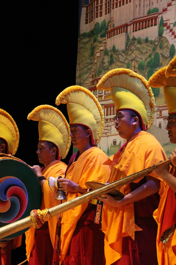 "In the prelude to ""Sacred Music Sacred Dance"" the monks invoke creative awareness within themselves and the audience through a tapestry of instrumental and vocal sounds. (Jessica Ngo)"