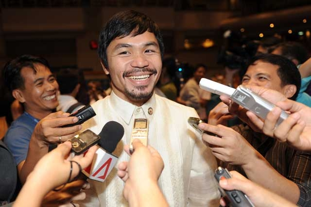 Philippine boxing hero and now congressman Manny Pacquiao speaks to members of the media during an orientation seminar at the House of Representatives in Manila on July 8, 2010. (Ted Aljibe/AFP/Getty Images)