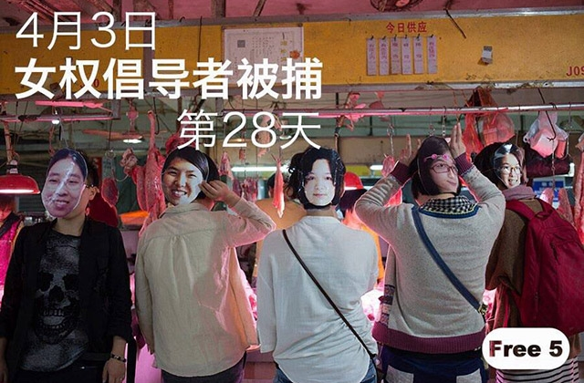 Masked activists pose at a market.