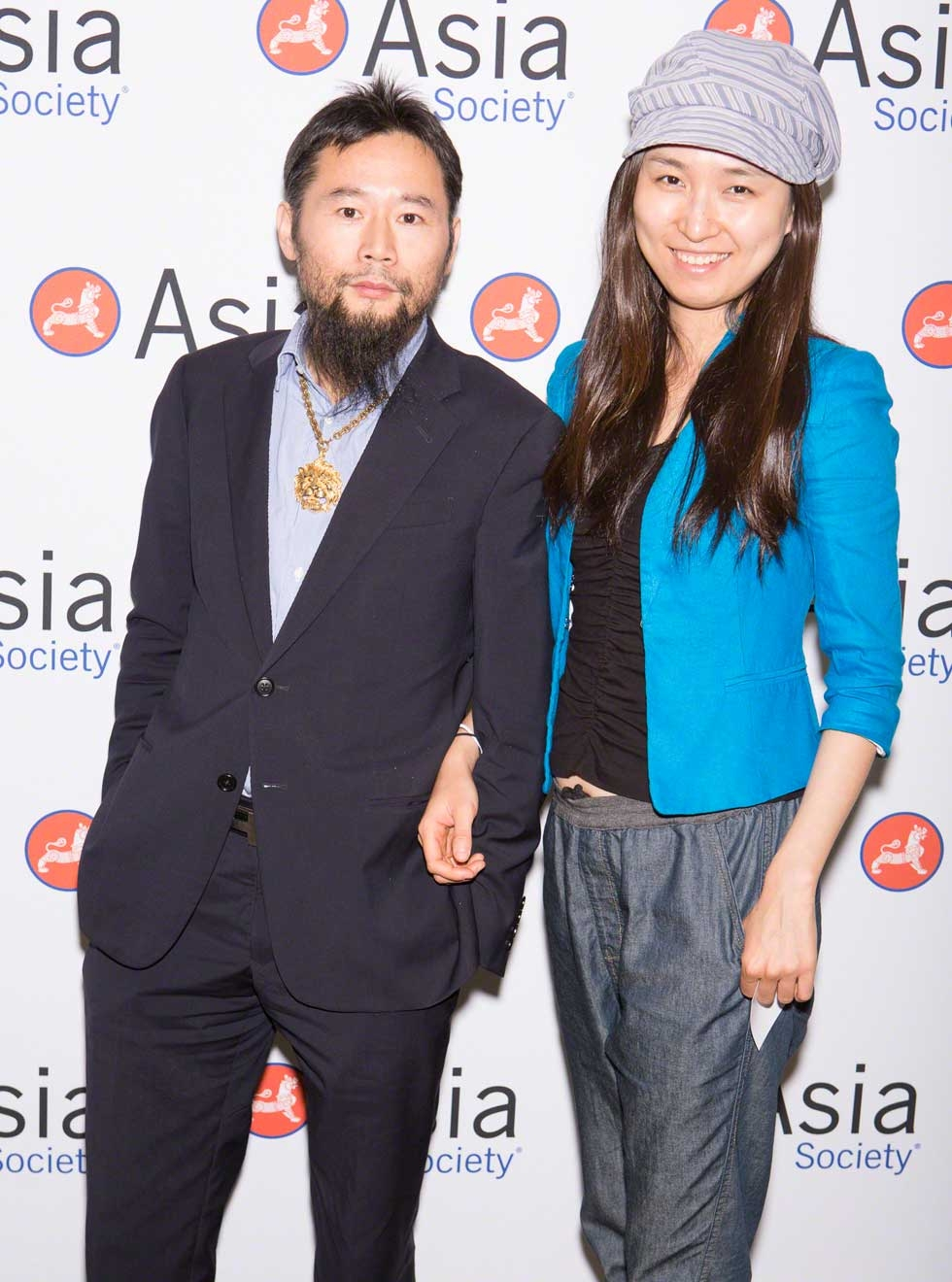 Stylish couple Liangang Sun and Dawei Wang at the Awards Dinner. (Bennet Cobliner)