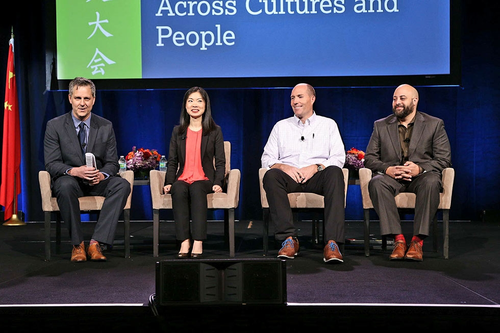 "(L to R) Dan Washburn, Carrie Xu, Chad Lewis, and Rafael Stone speak in the second plenary session, ""Sports as an Ambassador Across Cultures and People."" (David Keith/David Keith Photography)"