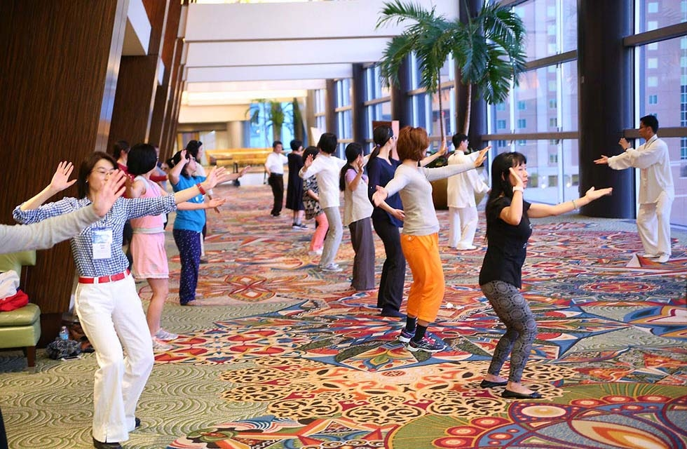 Conference attendees learn Tai Chi before the day's programs begin. (David Keith/David Keith Photography)