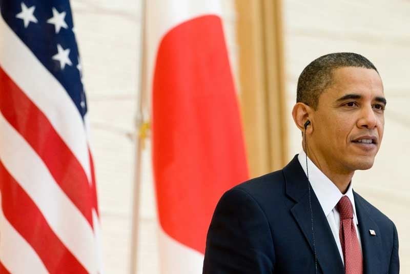 President Barack Obama attends a joint press conference with Japanese Prime Minister Yukio Hatoyama (unseen) at Kantei, the Prime Minister's office and official residence, in Tokyo on November 13, 2009. (Saul Loeb/AFP/Getty Images)