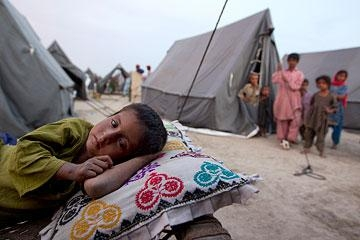 A boy rests at a new camp that opened on Aug. 14, 2010 for flood victims in Sukkur, Pakistan. (Paula Bronstein/Getty Images)