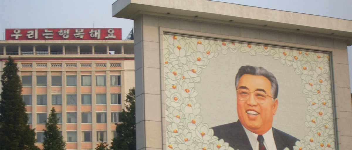 A mural of Kim Il Sung in the foreground (Anne Hilton)