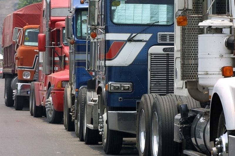 A queue of trucks, similar to those which transport goods inter-state and across national borders, stands 04 August 2001 in Mexico City. (Ramon Cavallo/AFP/Getty Images)