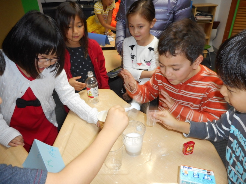 Students demonstrate scientific experiments at the annual science fair. (NWCA staff/parent)