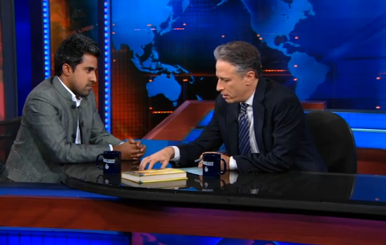 Anand Giridharadas with Jon Stewart on Jan. 24, 2011. (Comedy Central)