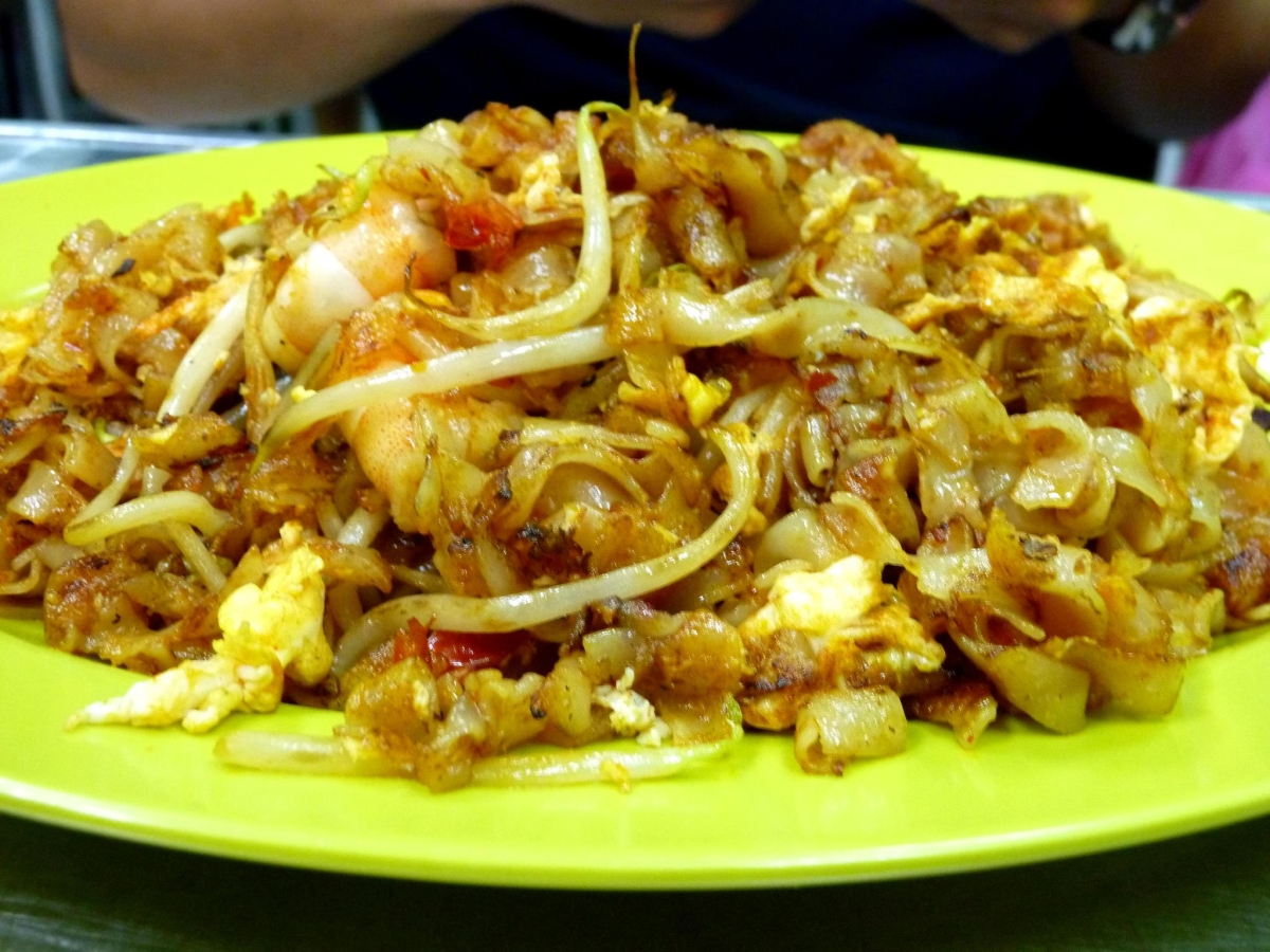 Char kway teow, stir-fried rice noodles with dark soy sauce with shrimp, egg, and sometimes cockles, from Singapore. (Saki Yuen)