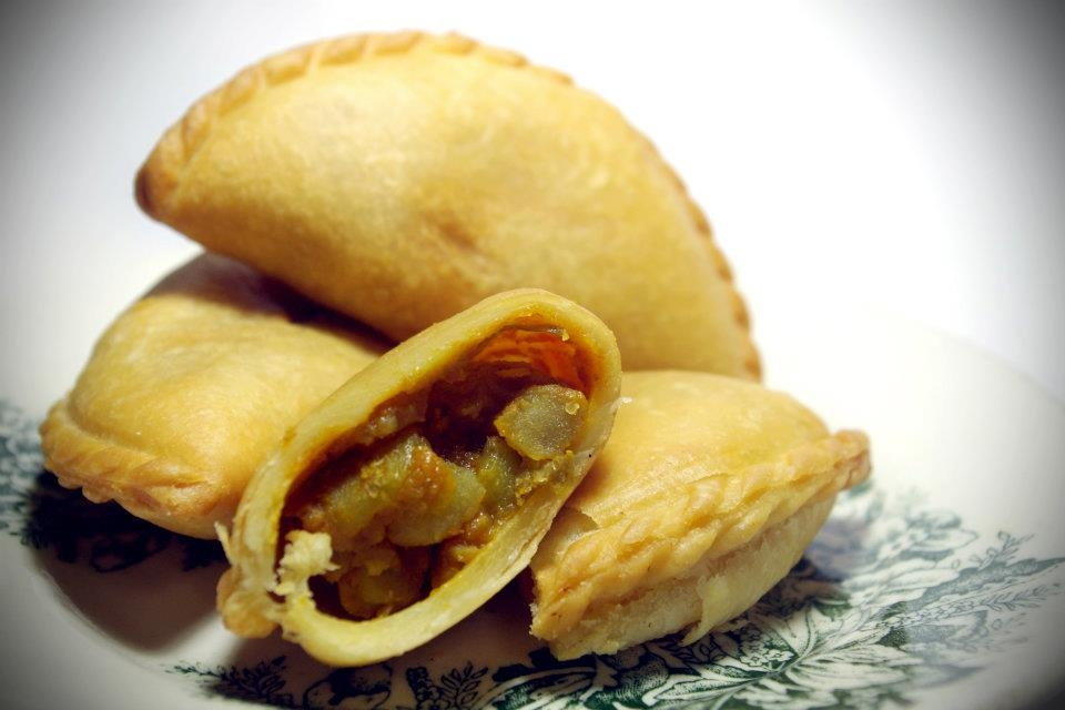 Curry puffs are deep fried fritters that resemble empanadas with curried potatoes and sometimes chili sardines. In Singapore, they are commonly sold by bicycle vendors or the back of vans. (Saki Yuen)