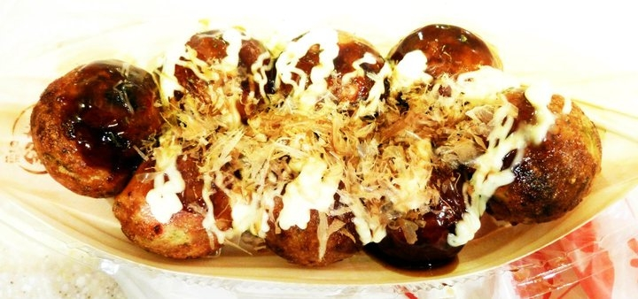 "Takoyaki, ""grilled octopus,"" are ball-shaped snacks commonly sold at festivals, or matsuri, in Japan, and have octopus, ham or even cheese stuffed in them. (Saki Yuen)"
