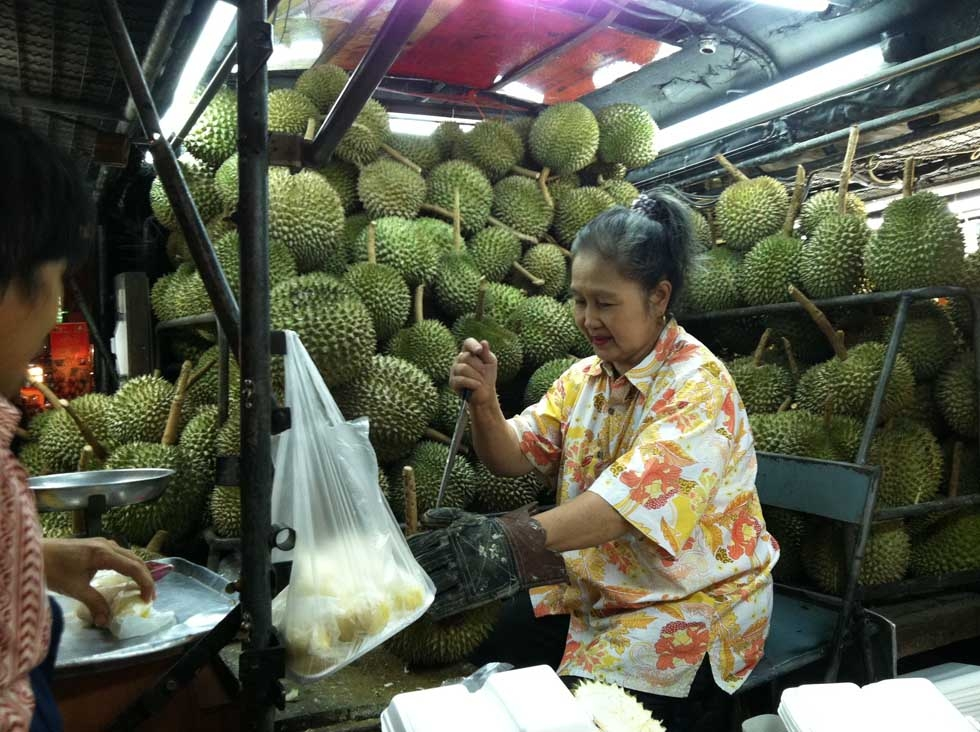 In Thailand, a street vendor selling the notoriously fragrant fruit known as durian. (Kavi Reddy)