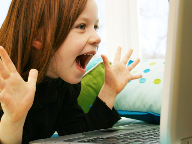 A child reacts in excitement (killerb10/iStockPhoto)