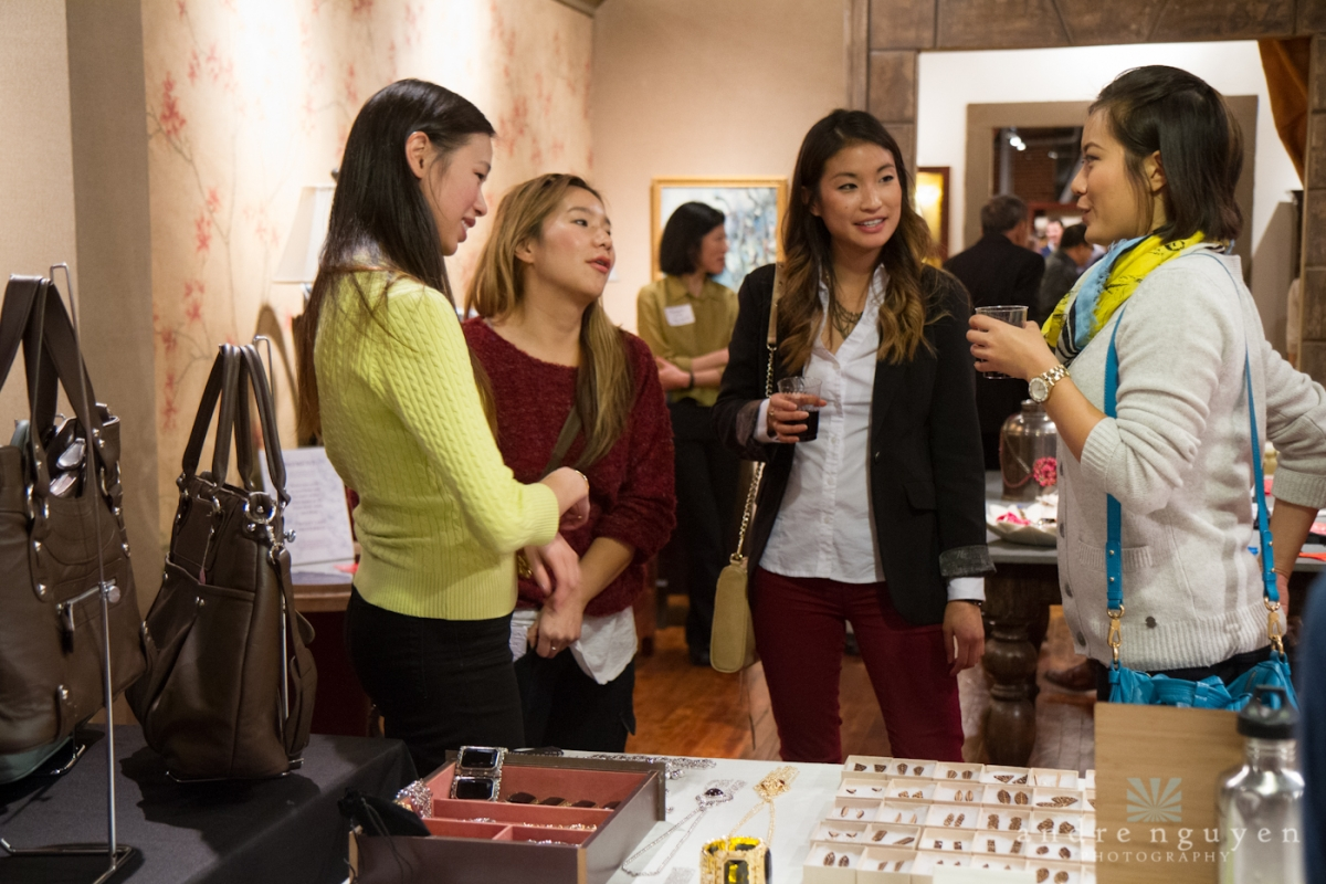 Unique Indie founder Janet Hu visits with shoppers