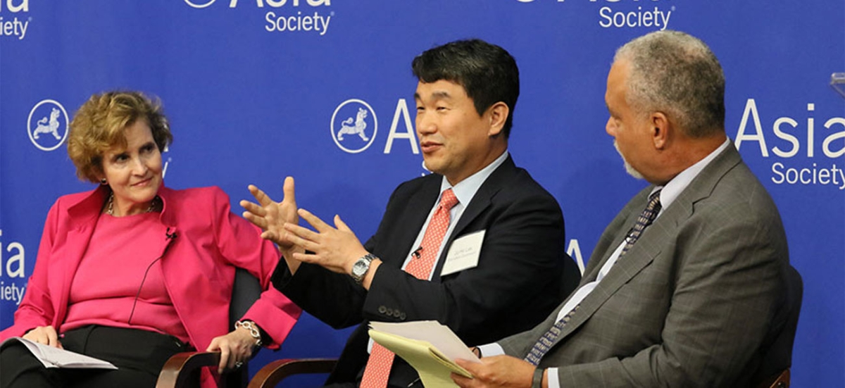 "Ju-Ho Lee, Education Commissioner and former Minister of Education, Republic of Korea, speaks during the panel, ""Implications for the Education Sector."" To his left, Alice Albright. To his right, Tony Jackson. (Ellen Wallop/Asia Society)"
