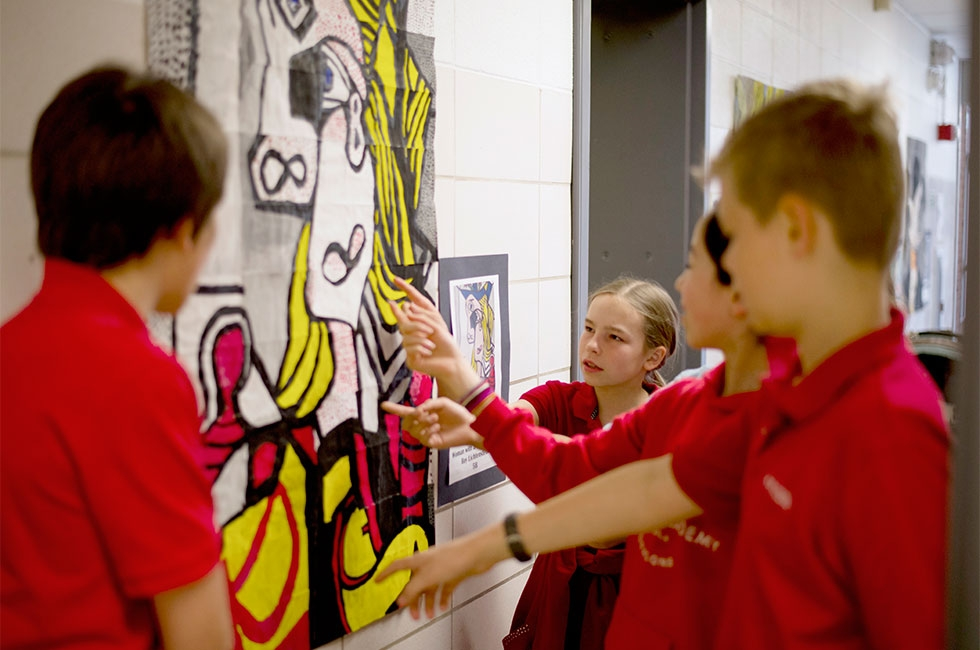 Each middle school class annually completes a large-scale collaborative painting based on a master work such as Roy Lichtenstein's Woman with a Flowered Hat. Students use a grid system to proportionately enlarge an image. (Jennifer Hakes/Yinghua Academy)