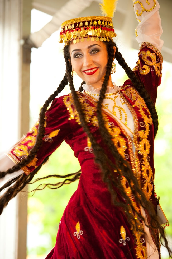 Mariam Gaibova entertains visitors with a head-spinning Tajik dance (Jeff Fantich).