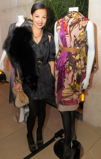 Designer Thuy Diep poses with her contribution to the silent auction. (Elsa Ruiz/Asia Society)