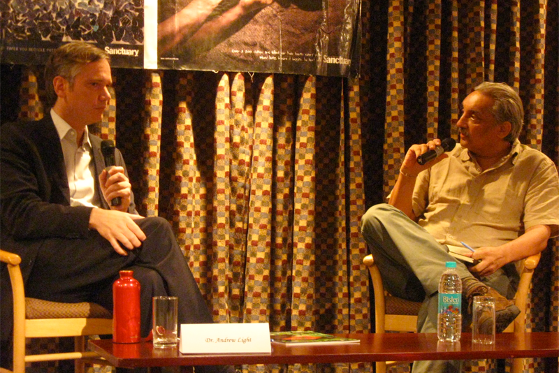 Dr. Andrew Light, left, discussed climate change policy with Bittu Sahgal.