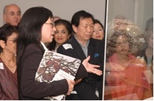 APAC members watch as MFAH Curator Christine Starkman gives tour of Arts of Korea Gallery. (Asia Society Texas Center)