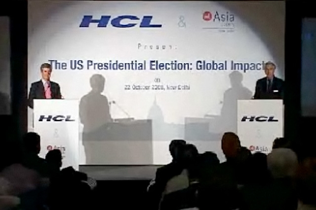 Richard Burt and Nelson Cunningham, the campaign advisers for the US presidential elections, debate in Mumbai.