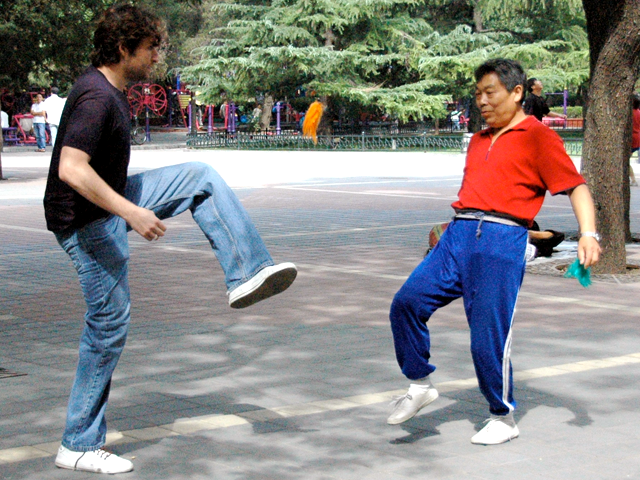 Joshua (left) playing jianzi, a Chinese game similar to hacky sack, in a Beijing park. (Joshua Halpern)