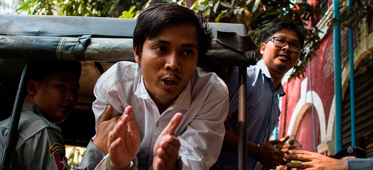 Detained Myanmar journalists Kyaw Soe Oo (C) and Wa Lone (R) talk to the media after making an appearance at their ongoing trial on February 14, 2018 in Yangon.