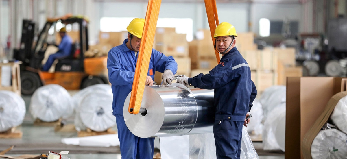 Workers package sheet aluminum at a factory in Huaibei in China's eastern Anhui province.