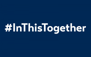 In This Together hashtag in white on an indigo background